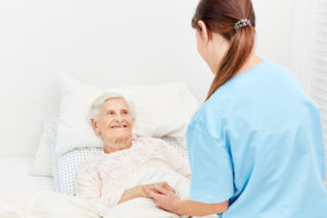 Old woman in bed in hospice or nursing home